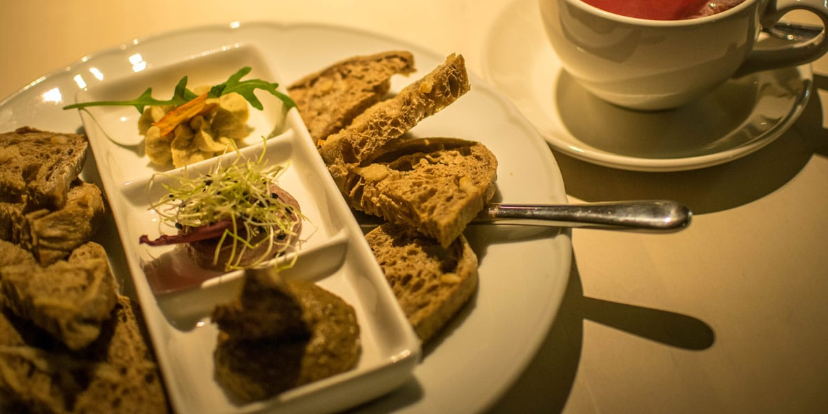 The entree at the Vegan Restoran V in Tallinn; a trio of delicious mousses with crunchy garlic bread.