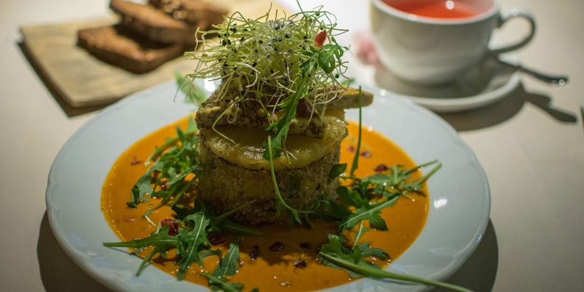 The main course of the Vegan Restoran V: Spicy tofu with quinoia and a pumpkin sauce.