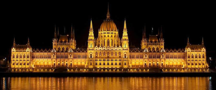 The parliament of Budapest is bathing in gold once it gets dark outside.