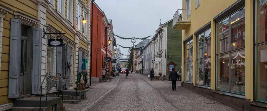 The colorful streets of Porvoo, with many shops and restaurants scattered through the village.