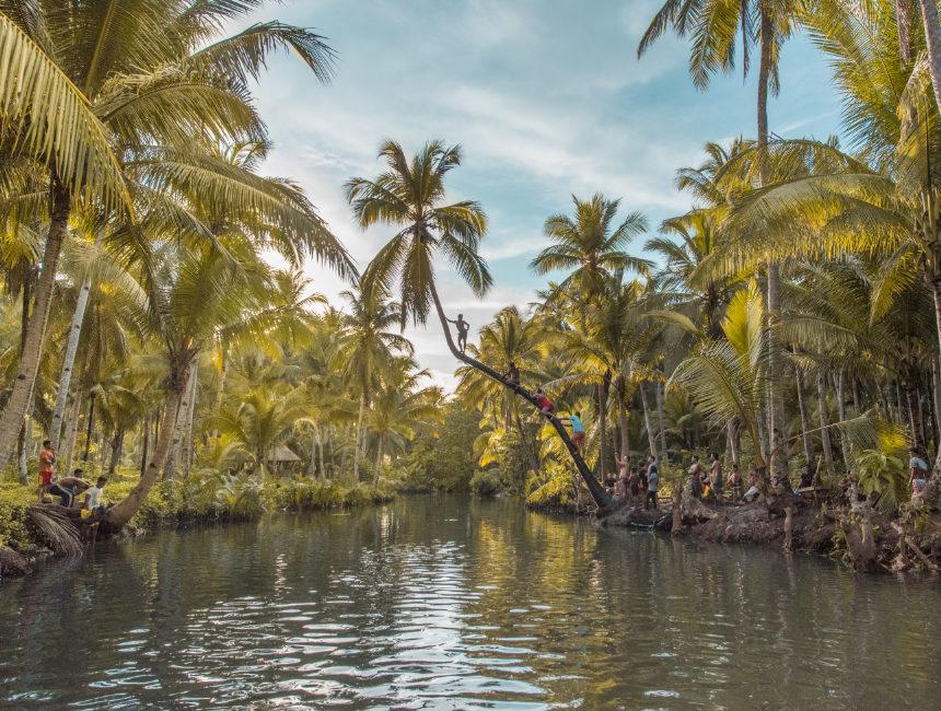 what to do in siargao maasin bridge palm tree swing